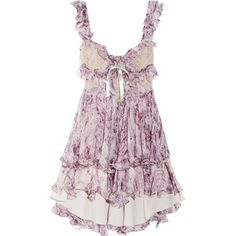 GORGEOUS LACEY & FRILLY SUMMER DRESS.  This dress is breath-taking. And it should be for the price it is marked (a little under ten thousand dollars). This dress is designed by Alexander McQueen.