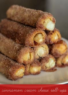 Delicious Cinnamon Cream Cheese Roll Ups - a simple and yummy breakfast treat. { lilluna.com } White bread flattened and rolled with a cream cheese and powdered sugar mixture, dipped in butter, cinnamon, and sugar!
