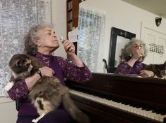 old woman with her cat, piano and a joint