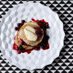 Clotted cream is the perfect match for the hot, spicy summer berries that top the pancakes