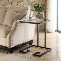 Update the look of your home with the Avery Glass Top Accent Table. This table features a stylish contemporary design that is sure to blend well with a variety of different decors.