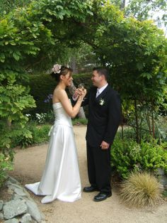 Cambria Pines Lodge wedding hands-intertwined toast under the arbor