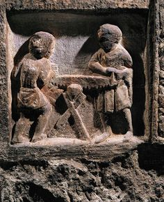 Two men sawing at a piece of wood. Funeral stele of a carpenter from l'Isle Saint Jacques, France. Musee d'Art et d'Histoire, Metz, France
