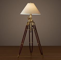RH's Royal Marine Tripod Floor Lamp:A reproduction of a British surveyor's tripod, our lamp is crafted of solid wood or aluminum with solid cast metal accents that have a warm, lustrous finish.