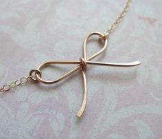 Bow Necklace - Handmade delicate bow necklace. No two bows are the same – but they are all very similar in size. Choose from a rose gold, gold, or silver bow on a rose gold, gold, or silver chain. Lovely! Necklace measures 16 inches long. Bow measures just under an inch.