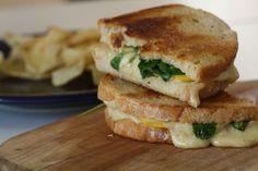 Grilled cheese using summer peaches, Gruyere cheese, and fresh arugula. A fantastic summer sandwich!