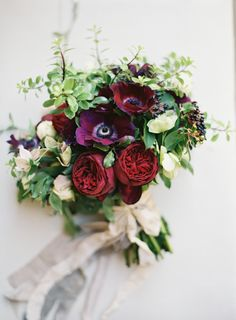 Romantic red and burgundy blooms: http://www.stylemepretty.com/2016/07/14/forget-catching-pokemon-catch-these-wedding-bouquets-instead/