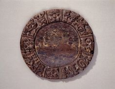 Photograph; Divination Tray Circa. 19th Century Cultural group; Yoruba Peoples  Country; Nigeria Materials; Wood  Measurement; diam. 38.00 cm. Housed; Fowler Museum at UCLA Gifted; Ralph B. Lloyd Foundation Museum Purchase; X70.646 COPYRIGHT © Fowler Museum
