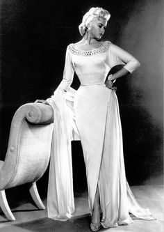 Jayne Mansfield.  Not a post or clothing from the Art Deco period, but a very Deco-looking chair she's leaning against.