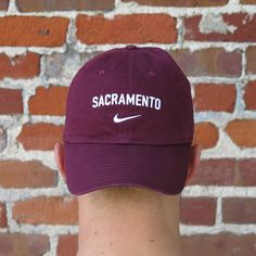 6d2fba9bf57111 Six Panel adjustable washed cap. Embroidered SACRAMENTO on the front  centered over an embroidered Nike swoosh. Cotton Adult One Size Softly  Structured