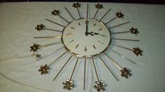 Vintage 1960's Starburst Clock - Goldtone with Flowers and Spokes - Works Great!