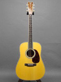 Martin D-42 Custom (2011) : Ordered by Gruhn Guitars. Adirondack Spruce top, Madagascar Rosewood back & sides.