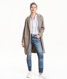Beige melange. Straight-cut coat in a wool blend. Slightly dropped shoulders, patch front pockets, and no buttons. Vent at back. Unlined.