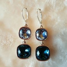 Baby Blue And Teal Pendant Earrings Very nice pair of earrings. Great quality and the colors are really beautiful. Brand new, never worn. Anne Klein Jewelry Earrings