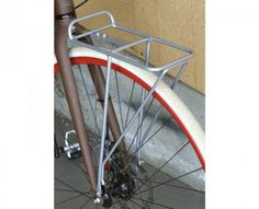 Soma Mini Front Rack - very affordable and holds my gear well. Perfect for a front rack bag