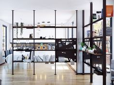 Floor-ceiling mounted cast iron bookcase GIOSTRA by Damiano Latini