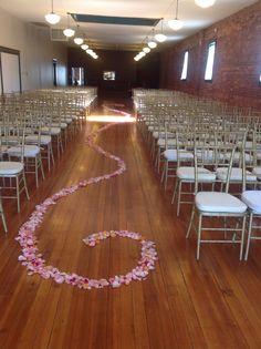 Our aisle has fresh rose petals ready for our brides entrance.