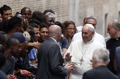Pope greets Francisco refugees queuing for food in the center of Rome Astalli, during his private visit to the Jesuit Refugee Service. (AP)