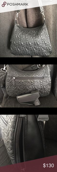 """GUN TOTE 'N MAMAS FLOWER EMBOSSED CCW SHOULDER BAG BRAND NEW WITH TAGS!!! Black Super Soft Leather, Steel Reinforced Shoulder Strap, Dual Access w/ Holster, Light in Weight, 2 Interior Sections!! 9"""" by 13"""" by 4"""" Strap Drop is 13"""" !! Gun Tote 'N Mamas Bags Shoulder Bags"""