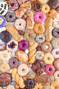 Yummy Wedding Desserts for the Fun Artistic Bride: A glorious variety of doughnuts for the ultimate doughnut guide.