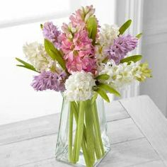 The FTD® Pure Perfection™ Bouquet http://www.thebloomingboutique.net/product/the-ftd-pure-perfection-bouquet/display