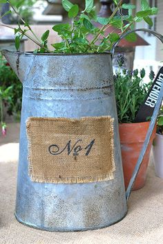 burlap with number on galvanized bucket