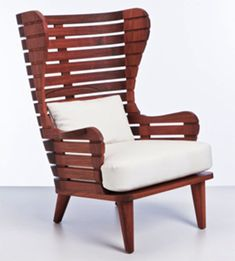 """Contemporary United States An Indoor/Outdoor Wingback Chair. Shown in Machiche. Made to order, can be customized with various finishes and wood types available. Ottoman is available separately.  28"""" L x 32"""" D x 40"""" H  Price Upon Request"""