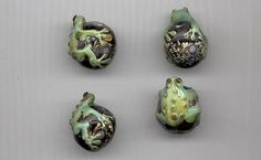 Four delightful lampwork glass beads with tree frogs by RNEVEBEADS