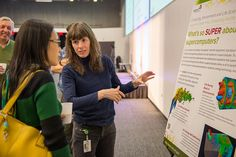 "Researcher Marta García Martinez (right) talks with an Argonne guest during a public lecture titled ""Rise of the Super Smart Supercomputer."""
