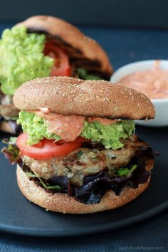 Healthy juicy Southwestern Turkey Burgers stuffed with lettuce, tomato, a simple guacamole, and a Spicy Aioli made with Piquillo Peppers and Chipotle Peppers! The ultimate Turkey Burger recipe your family will love - just 20 minutes!