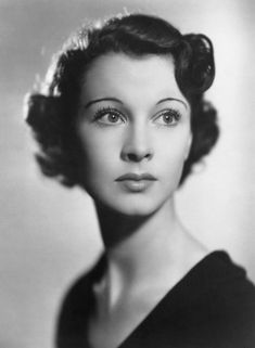 Vivien Leigh - it's amazing how much kinder she looks without the sharp eyebrows from Gone with the Wind! I'm not sure why, but the soft black and white reminds me of Burning Midnight. I imagine it being softer or sharper most of the time, like the forties - sixties.
