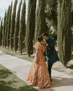 This couple had a cute photoshoot amidst beautiful greens. The bride looked gorgeous in her chevron orange lehenga and the groom looked dapper in his blue sherwani. Pc: Nehavermaa #prewedding #preweddingshoot #photography #indianwedding #wedding #bride #wittyvows Pre Wedding Shoot Ideas, Pre Wedding Photoshoot, Blue Sherwani, Orange Lehenga, Groom Looks, Looking Dapper, Looking Gorgeous, Beautiful, Bride Look