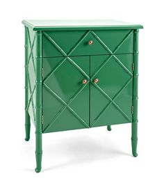 The Emilia chest is a visual treat in bright Green with bamboo-shaped legs and detailing. A stylish storage solution, it features a slide-out drawer and cabinet space behind double doors. Brushed Nickel hardware accent pulls complete the look. Bamboo Design, Wooden Chest, Cabinet Space, Locker Storage, Kitchen Storage, Drawers, Furniture, Home Decor