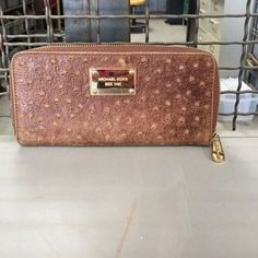 I just discovered this while shopping on Poshmark: Used Michael Kors wallet brown. Check it out!  Size: OS