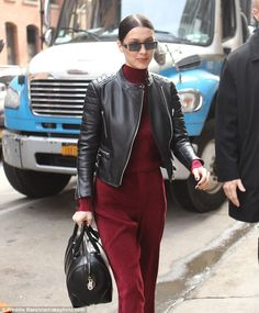 Stylish: The 20-year-old fashion model looked elegant and chic in a high-neck bold crimson...