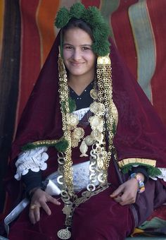 Africa | A nomad Tunisian woman girl in a traditional dress attending the 39th International Sahara Festival in the town of Douz | ©Fethi Belaid