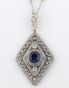 A sapphire and diamond pendant  with diamond and platinum necklace; oval-shaped sapphire weighing approximately: 2.10 carats; estimated total diamond weight: 1.50 carats; pendant mounted in platinum-topped gold; necklace length: 17 1/4in.  If it's platinum on gold, it's at least Edwardian.