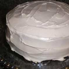 """White Almond """"Wedding"""" Cake: SHUT THE FRONT DOOR.  This is the BEST cake hands down.  Oh my gosh.  Super moist.  I subbed in plain greek yogurt for the sour cream. Best cake ever.  My mouth waters thinking about it even now.  Will be making over and over and over.  Frosting was a Butter Frosting from my BH cookbook."""