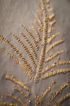 Pleasant View Schoolhouse: Alabama Chanin: Golden Ferns - I used a mix of two fabric paints from Hobby Lobby--one part French Roast to two parts Pond Scum--for a kind of neutral sparkle, then chose a cool non-metallic golden floss for my modified satin stitch embellishment. I'm going back over the fern fronds adding a golden bead here and there. Soon I'll stitch it all together and it will be an elbow-sleeved bolero.