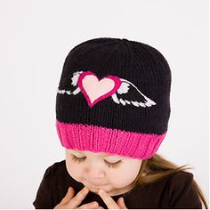 The Loving Angel Wings Baby & Kids Beanie Hat from www.Melondipity.com is a great everyday hat for your baby girl. This beanie is hand-woven from super soft bamboo yarn and is lined with a soft jersey cotton material. The hat features a black upper portion and a pink border rim with an embroidered heart and angel wings. This product will be a great addition to your little girl's wardrobe as it will match virtually any outfit. Price: $33.50