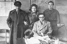 Former SOE F Section intelligence officer/assistant Vera Atkins in office with war crimes investigators