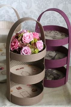 Easy Recycle Craft - You could use plastic lids to create this look!Three tier display - photo only. Old cake pans, cover, and line with vintage paper. Or sturdy cardboard rounds cut to size, I've seen large cardboard tubs tossed from the kitchen whe Cd Crafts, Diy Home Crafts, Crafts For Kids, Arts And Crafts, Paper Crafts, Creative Crafts, Diy Para A Casa, Carton Diy, Cardboard Crafts