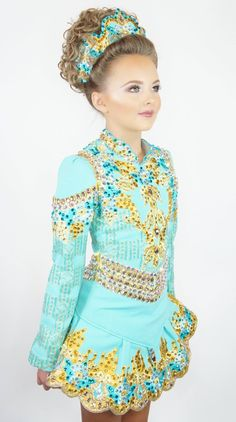 This little Irish dancer looks like a princess in her mint and gold solo dress