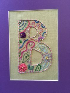 Brenda illuminated her initial. This was the 5th  grade after school project. Brenda designed this herself. She chose the colors, selected the stitches and worked very hard to have it completed by June. This is one of 20 5th grade initials stitched in 2017.