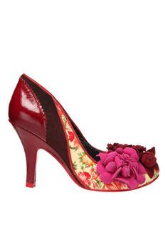 These amazing red heels are a combination of patent leather, suede, and a floral design all mixed together for a fun and festive heel with flower detailing at the toe.