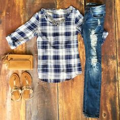 Sheer navy and white plaid blouse with cinched back