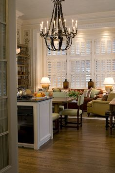 Portfolio Gary McBournie Inc. *Love the wall papered framed side panels next to the windows, which are great stacked plantation shutters