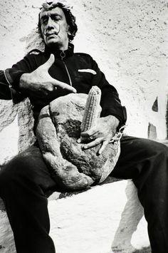 Salvador Dalí pointing at his corn dick, 1967