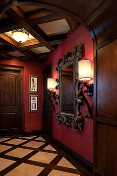 Foyerv by Rejoy interiors. ~Loving this heavy black baroque mirror, red walls, and wool inlaid walls, like a castle. ~Hexotica