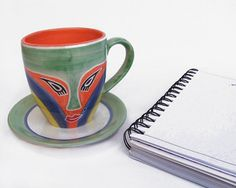 Hand painted coffee mugs + free saucer   Thoughful unique gift   Beautiful green, orange, blue and yellow lady mask coffee mug and tea cup